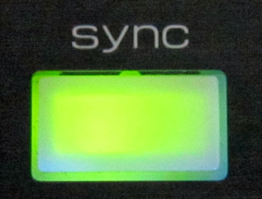 Sync button from a Vestax VCI-100.